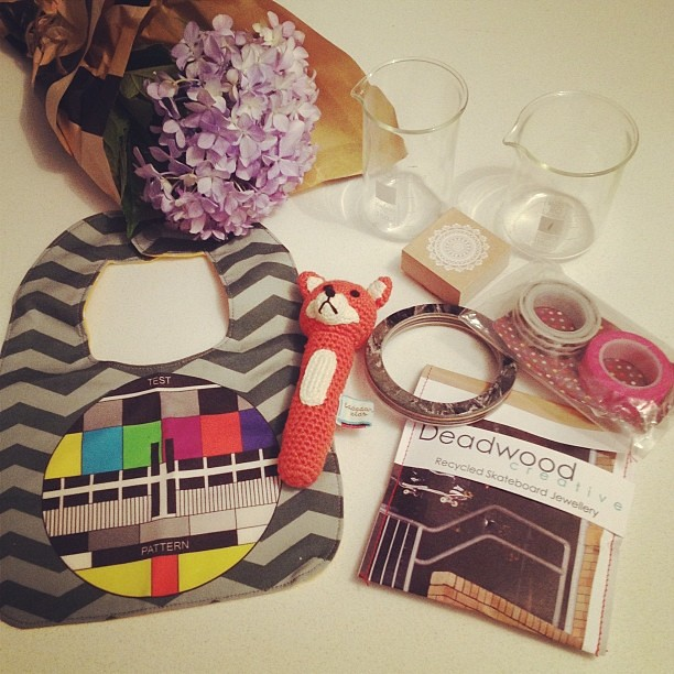 Finders Keepers goodies! Bubba's first rattle (thanks to @paravent) by Ladedah Kids, Test Pattern bib by @curlypops, Deadwood Creative recycled skateboard bangles (one for me and one for @noniponyhappy for Christmas), washi tape from @rabbitandtheduck, do
