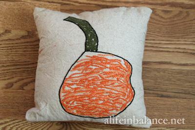 Make Kids Art Permanent: Embroidered Pumpkin Pillow