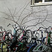 2013.04 - 'A close-up of parked bicycles and gentle branches', in the sun-light of Spring - on the corner of Hoogtekadijk and Matrozenhof, in district Kadijken, city Amsterdam; urban photography, Fons Heijnsbroek