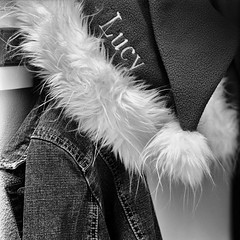 wing(0.0), textile(1.0), feather(1.0), fur(1.0), clothing(1.0), white(1.0), fur clothing(1.0), outerwear(1.0), monochrome photography(1.0), fashion(1.0), close-up(1.0), monochrome(1.0), black-and-white(1.0), black(1.0),