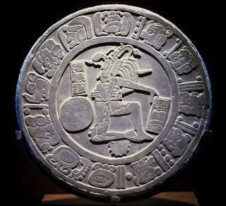 Marker disk with glyphs and central relief of a ball player