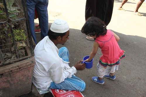 Charity Begins On The Streets ,, Nerjis Pays The Beggars She Shoots by firoze shakir photographerno1