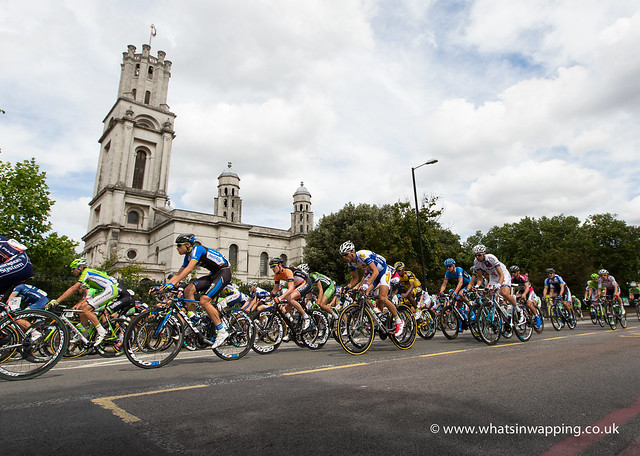 Pro cyclists in Ride London London-Surrey Classic pass Wapping