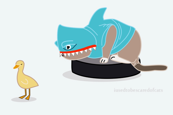 cat-chases-duck-on-roomba-in-shark-costume