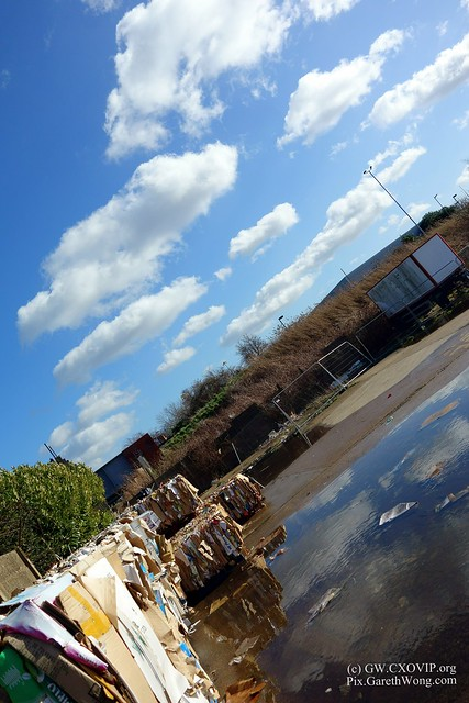 Recycling paper piled up with gorgeous sky clouds and reflection from RAW _DSC5709