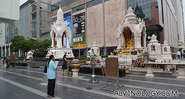Devotees praying to the famous Buddha statue outside Central World