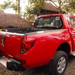 sport utility vehicle(0.0), automobile(1.0), automotive exterior(1.0), pickup truck(1.0), vehicle(1.0), truck(1.0), mitsubishi(1.0), bumper(1.0), mitsubishi triton(1.0), land vehicle(1.0),