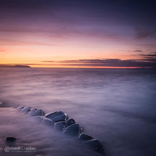 ocean uk sunset sea england beach water rocks europe glow unitedkingdom britain somerset severn kilve
