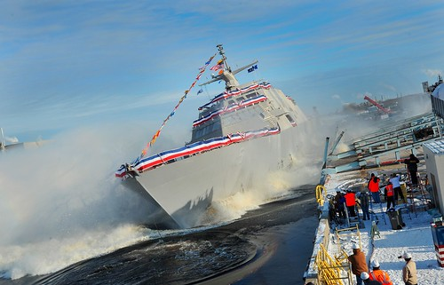 MARINETTE, Wis. - The crews of the Navy's newest littoral combat ship, Pre-Commissioning Unit (PCU) Milwaukee (LCS 5), conducted a mast-stepping ceremony at the Marinette Marine Corporation in Marinette, Wis.