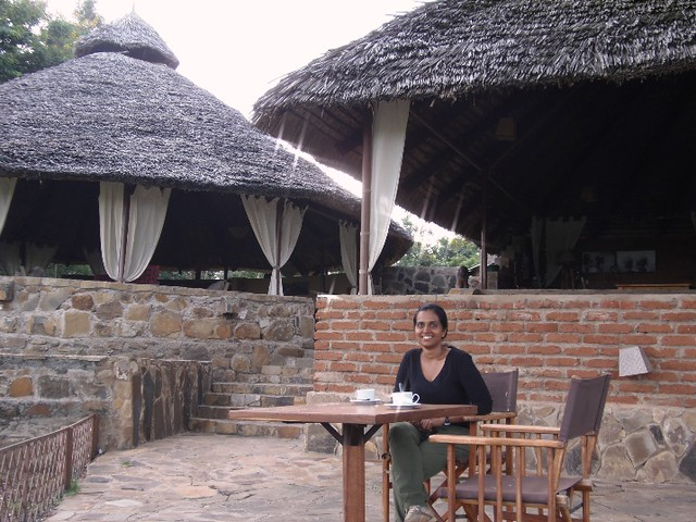A guest having coffee at Mikumi Wildlife Camp before starting morning game drive recently in Mikumi National Park
