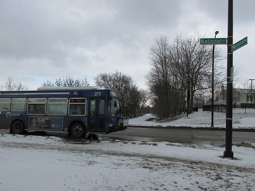 A Pace bus heads eastbound on National Street.  Elgin Illinois.  Monday, January 20th, 2014. by Eddie from Chicago