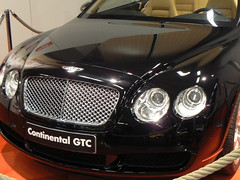 automobile(1.0), automotive exterior(1.0), bentley continental supersports(1.0), executive car(1.0), wheel(1.0), vehicle(1.0), automotive design(1.0), bentley continental gtc(1.0), bentley continental flying spur(1.0), rim(1.0), grille(1.0), bentley continental gt(1.0), bumper(1.0), personal luxury car(1.0), land vehicle(1.0), luxury vehicle(1.0), bentley(1.0),