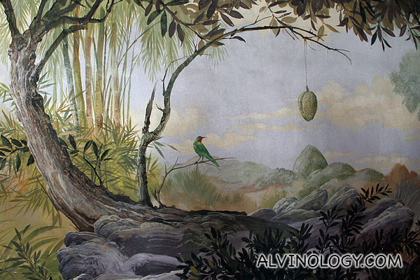 An interesting wall mural. I am not too sure durians grow this way...
