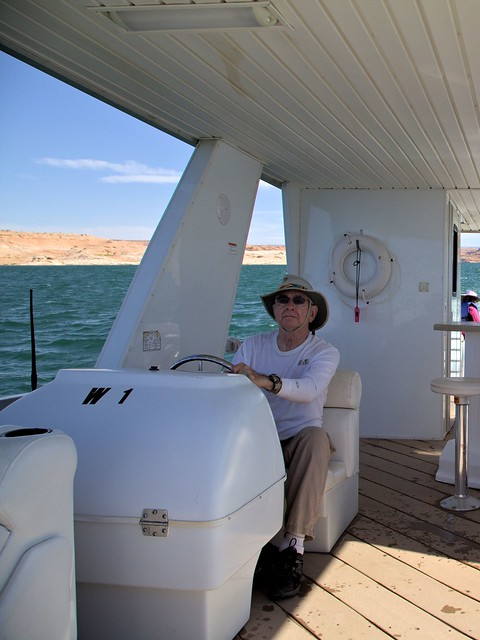 Ken at wheel of houseboat 20130621