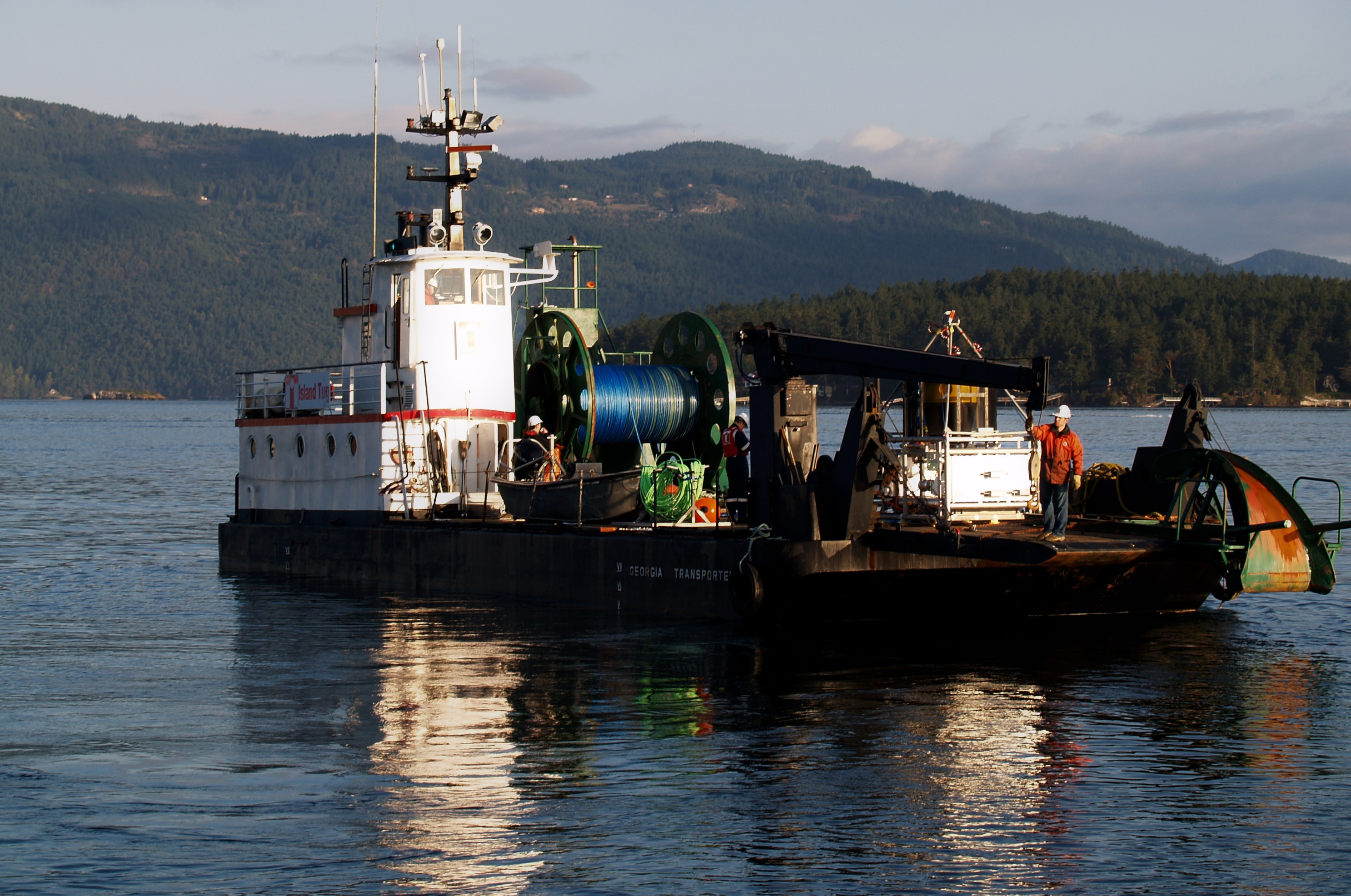 Island Tug's Georgia Transporter departs Swartz Bay with NEPTUNE Canada's Vertical Profiler System (VPS) and related equipment loaded on deck, 19 April 2010.