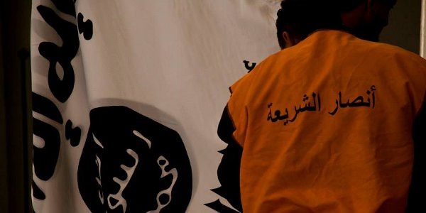 Ansar al-Sharia member with flag. Image courtesy: Ansar al-Sharia in Tunisia Facebook page.