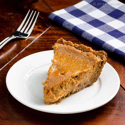 Sweet Potato Pie on plate with fork and napkin in background