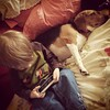 A boy and his dog and his iPhone.