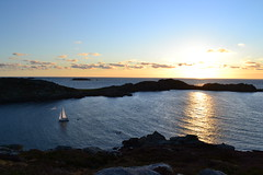 Yacht sails between Tresco and Bryher in the Scilly Isles