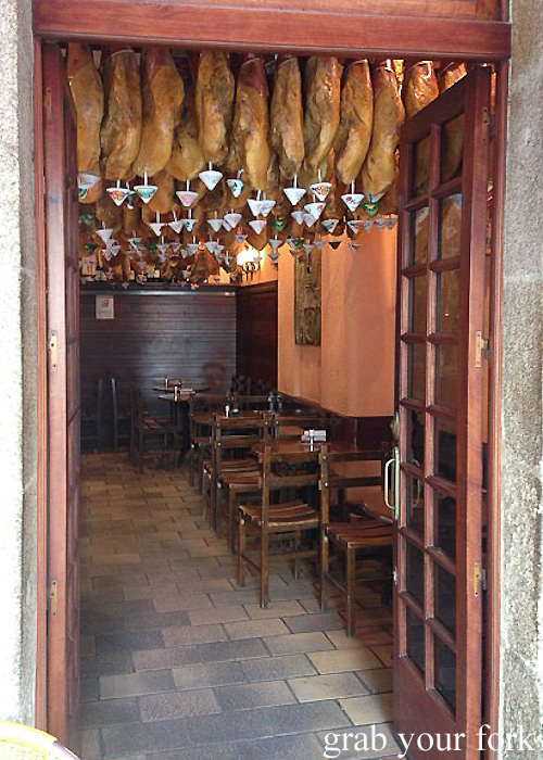 Jamon hanging from ceiling in a tapas bar in A Coruna, Galicia, Spain