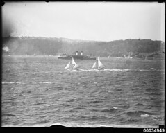 Two sloops racing near the ferry CURL CURL in Sydney Harbour