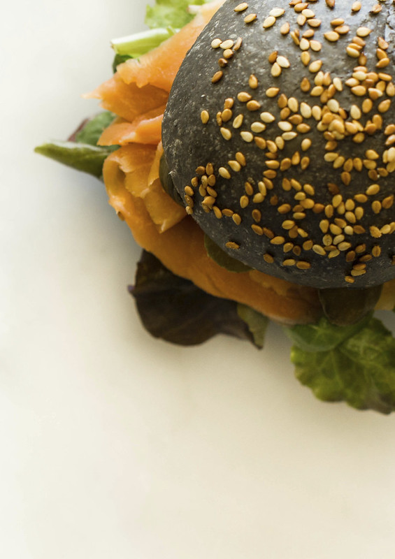salmon panino with squid ink black bread
