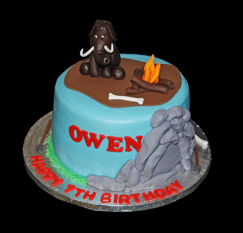 Caveman and Mammoth themed birthday cake for a Ice Age themed celebration