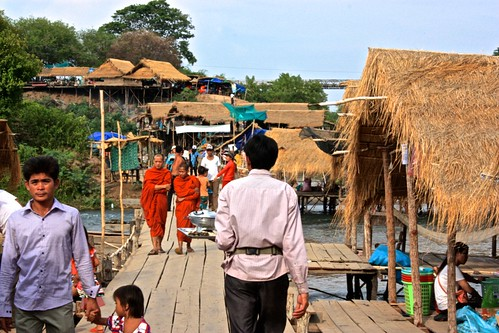 "the bustling ""boardwalk"" of the straw huts"