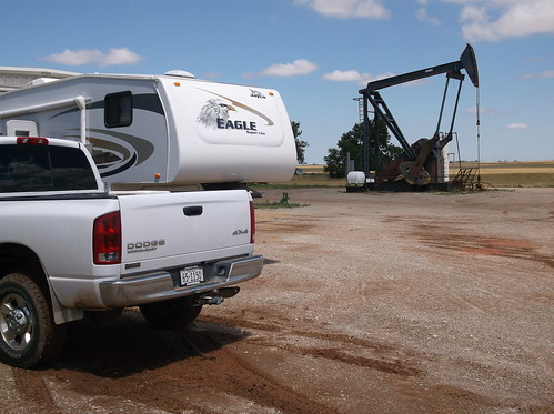 Camper by an oil well
