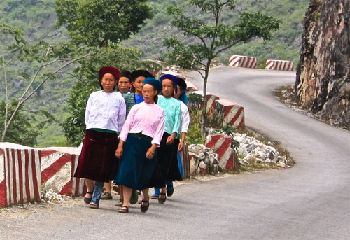 Women in traditional dress--looks like they may be coming back from a service