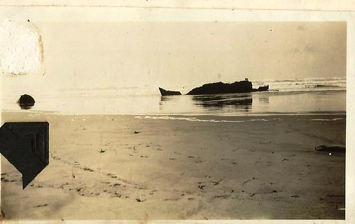 A shipwreck? Possibly on the Washington State  coast. No info on photo. by 912greens