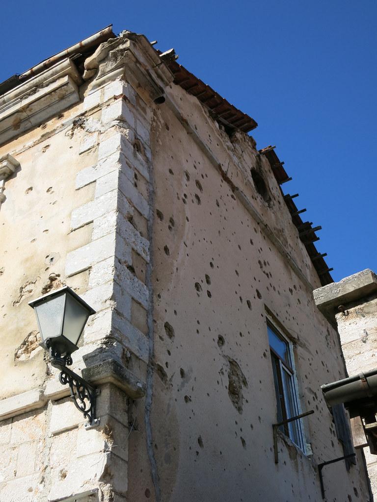 Bullet-ridden house.