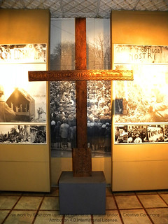 A carved wooden cross in the memory of the fallen in the Romanian Revolution Hall in the Bucharest National Military Museum