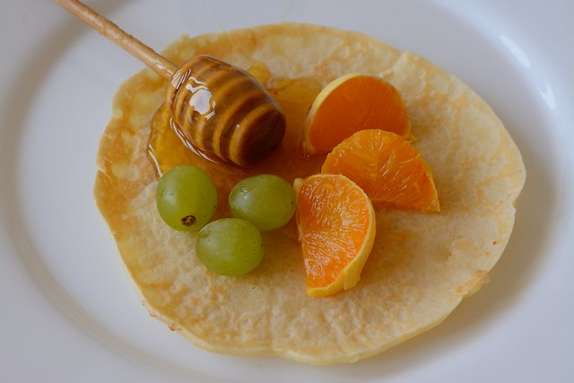 Pancake with fruit and honey (sweet)