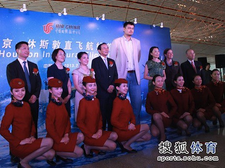 July 11th, 2013 - Yao Ming poses with Air China personnel before departing on the airline's inaugural flight between Beijing and Houston