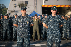 USS Freedom (LCS 1) Executive Officer Cmdr. Rich Jarrett and Command Master Chief Kenneth Jablecki stand in formation in front of Freedom Crew 102 during the ship's official turnover ceremony in Singapore, Aug. 6. (U.S. Navy photo by Mass Communication Specialist 3rd Class Karolina A. Oseguera)