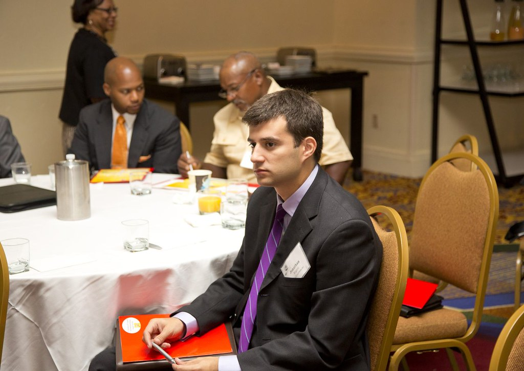 Attendees attentively listen to presentations.