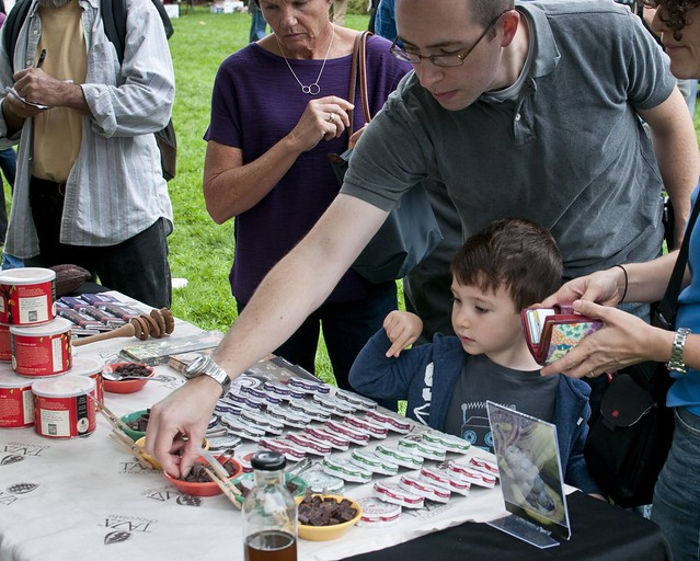 Visitors sample chile-chocolate creations. Photo by Michael Ratliff.