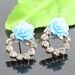 Small photo of Blauwe bloemen legering diamanten oorbellen