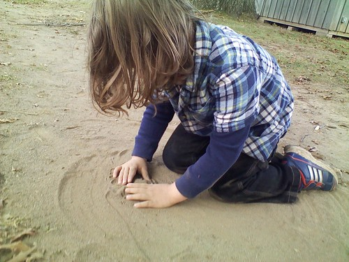Making a sand volcano...