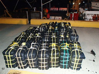 Twenty-five bales of cocaine weighing 2,546 pounds and with an estimated wholesale value of $34 million dollars rest on a boat pier in Ponce, Puerto Rico, Oct. 18, 2013, following the Coast Guard Cutter Drummond's offload of the contraband and transfer of three apprehended drug smugglers to Customs and Border Protection officers, Immigrations and Customs Enforcement (ICE)-Homeland Security Investigations, and Drug Enforcement Administration special agents in Ponce, Puerto Rico.  The drug shipment and apprehended smugglers resulted from an interagency at-sea interdiction Oct. 18, 2013, south of St. Croix, U.S. Virgin Islands.