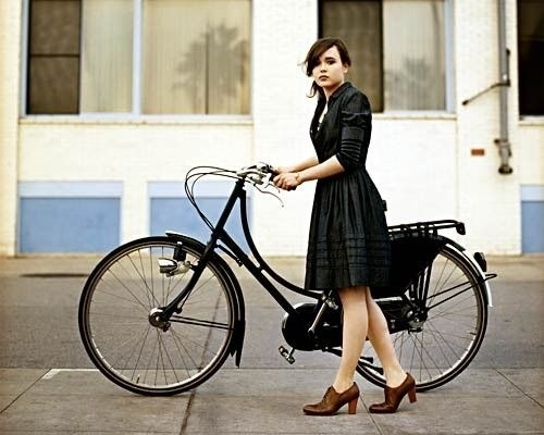 Ellen Page and her bike. Love the shoes.