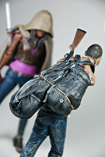 Michonne with Pet zombie with shotgun