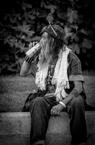 homeless man drinking beer