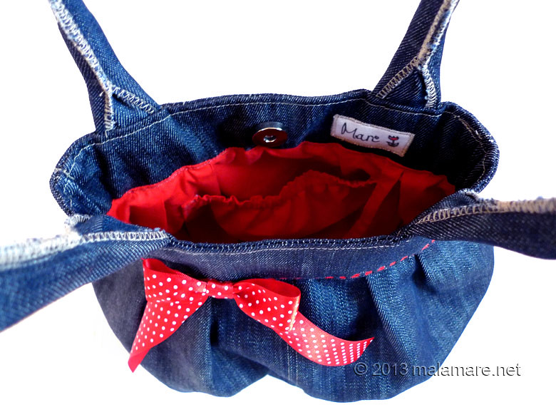 Upcycled blue jeans handbag with polka dot bow