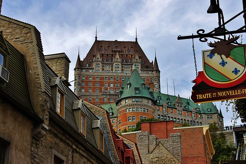 old city travel trees sky canada green sign architecture clouds canon buildings eos rebel scenery view quebec peaceful historic québec copper daytime quebeccity chateaufrontenac tranquil t3i québeccity fairmontlechâteaufrontenac copperroof 600d waltphotos lordwalt kissx5 architectbruceprice canonlensefs1855mmf3556isii