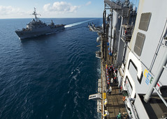 In this file photo, USS Denver (LPD 9) approaches amphibious assault ship USS Bonhomme Richard (LHD 6) for an underway replenishment in the Timor Sea, Sept. 2. (U.S. Navy Photo by Mass Communication Specialist 1st Class Joshua Hammond)