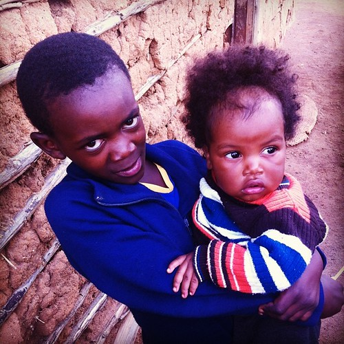 This baby had to weigh almost as much as the girl carrying her. #swazikids #precious #swaziland #swazilandtripnovember2013 #jesuslovesthelittlechildren