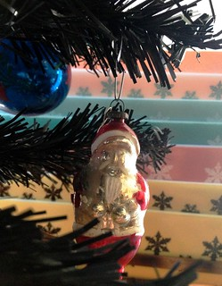 Vintage Santa peeking through the Christmas Tree
