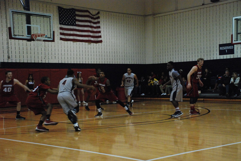 Avery Green (#4) drives into the lane, before drawing contact under the basket